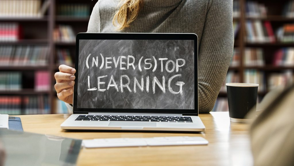 Never Stop Learning Image of Laptop in Library